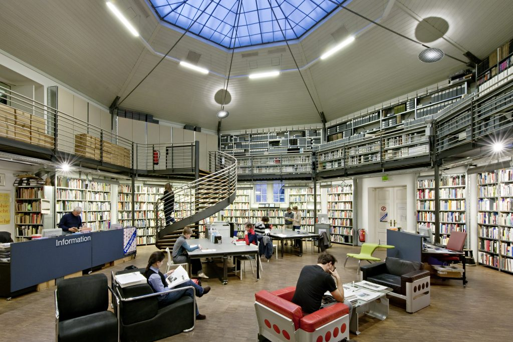 Interior of a library with bookshelves and reading areas