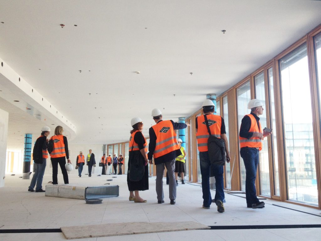 Group of people on a visit to a building site