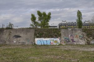 Old wall with graffiti in the wasteland on the Nordbahnhof site
