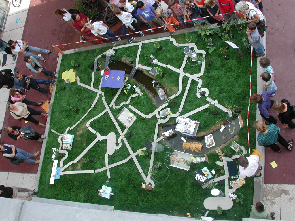 View of a model of the city with real lawn.