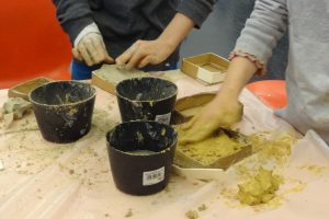 Two children working with clay.