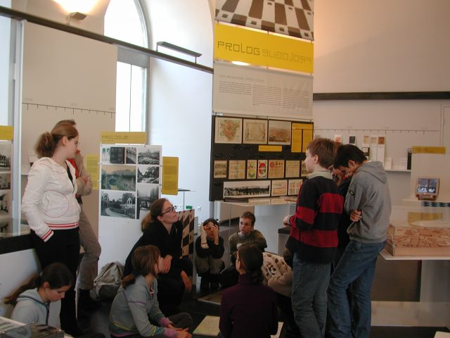 "Group of school students in the permanent exhibition ""a_schau"""