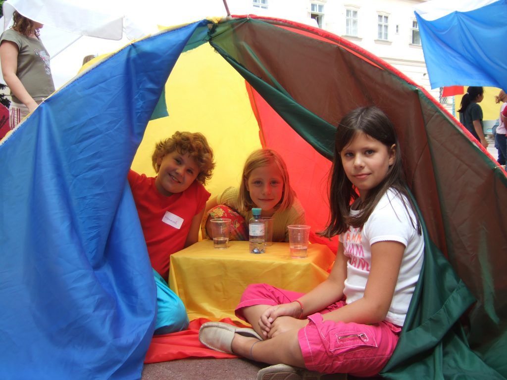 Children in a tent they have built themselves