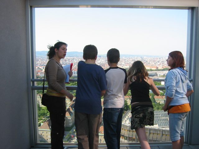 Group of school students looking at the city of Vienna from above