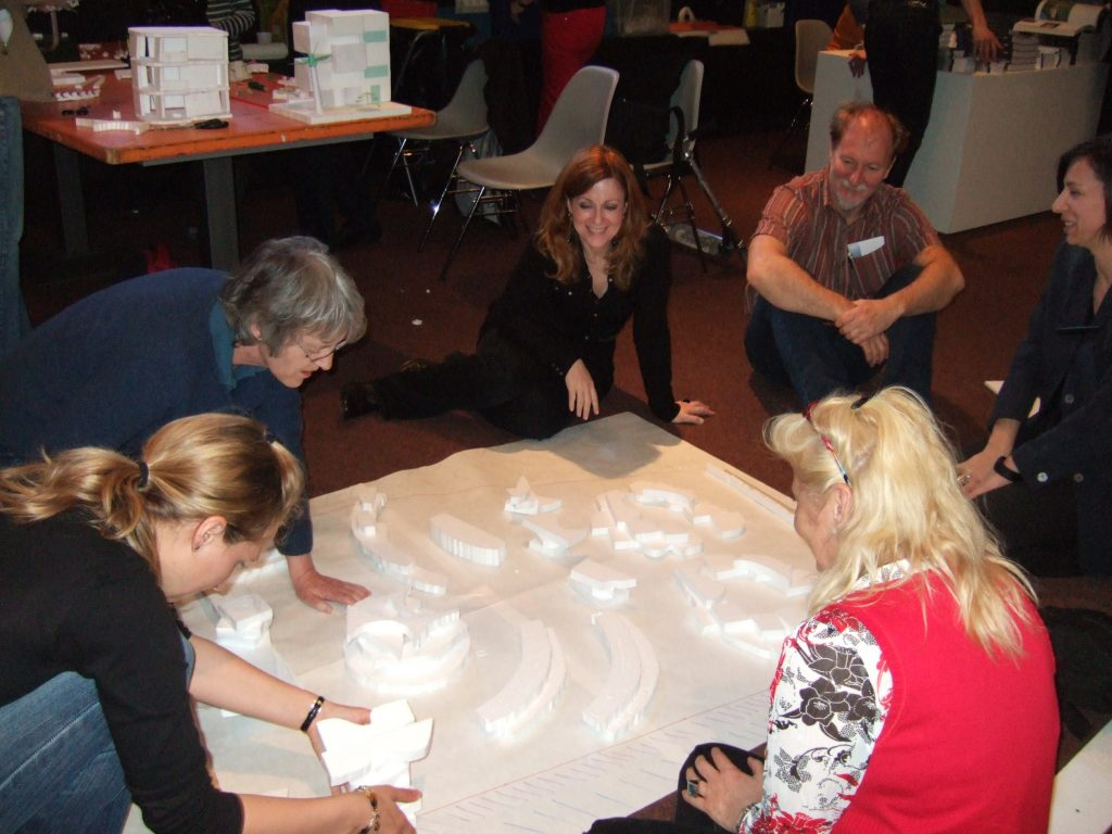 Participants in a workshop discuss their city model.