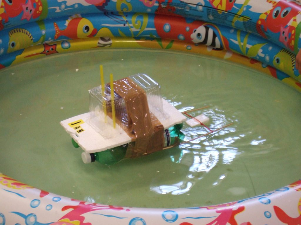 Model house floating in a small pool