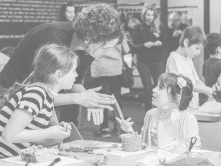 An educationalist with two children at a workshop