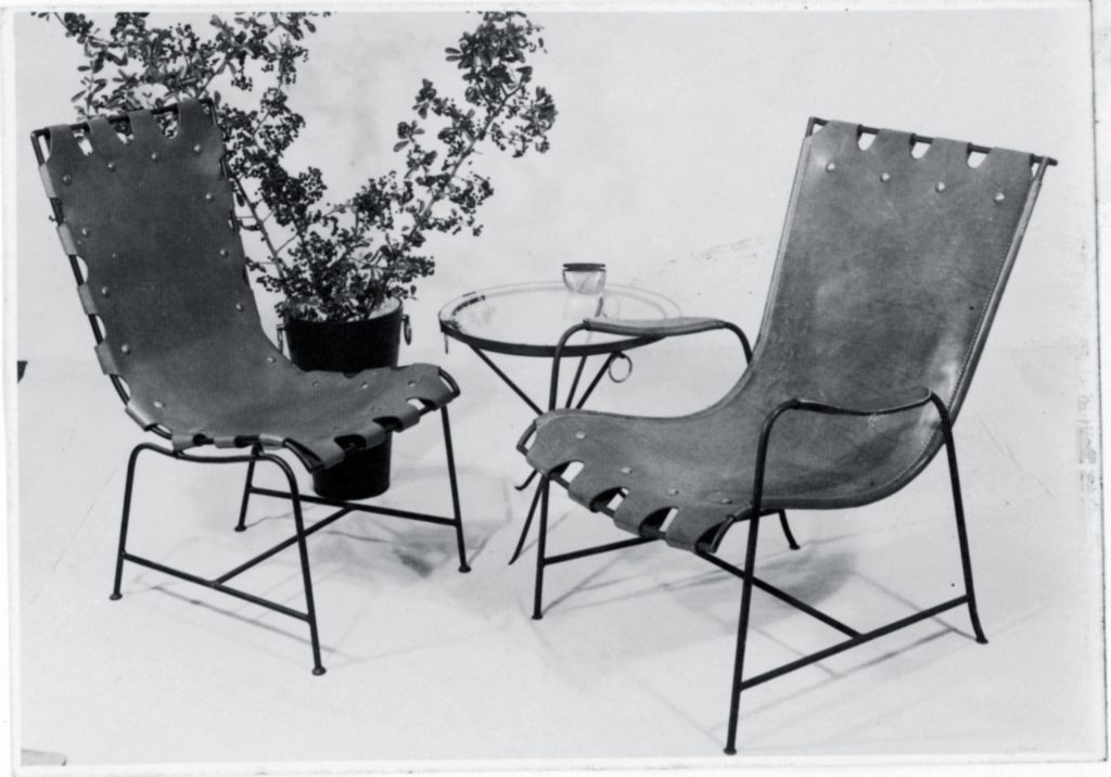 Two iron chairs with leather covering