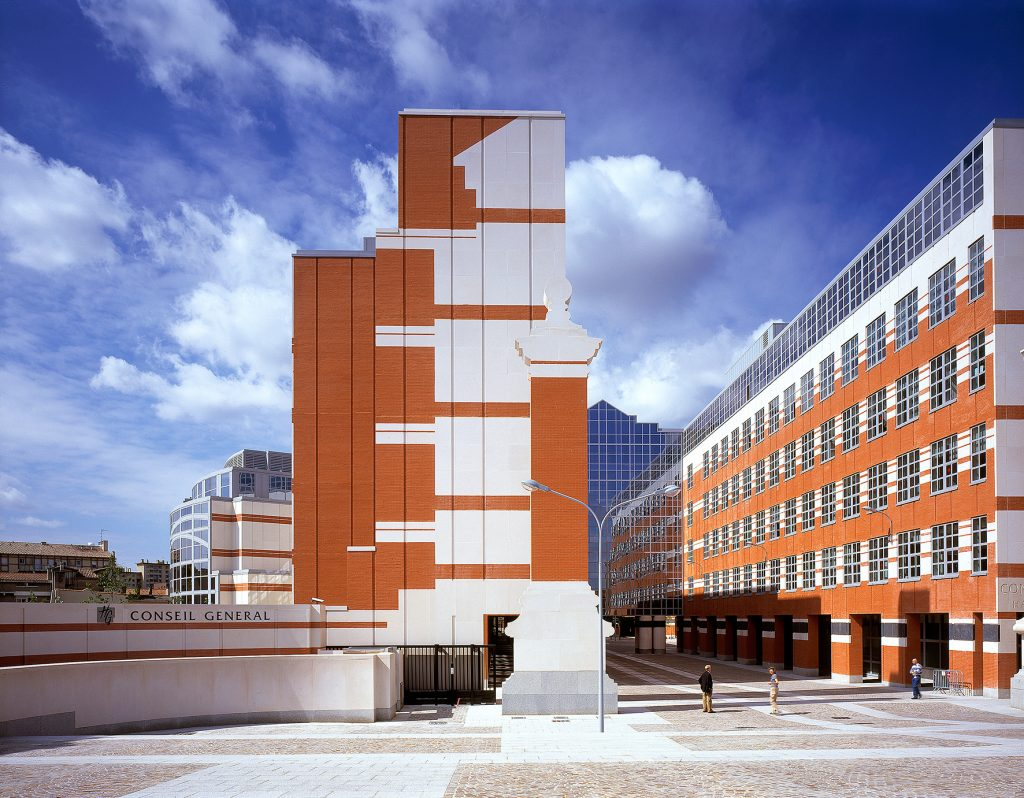 a orange and white building without windows