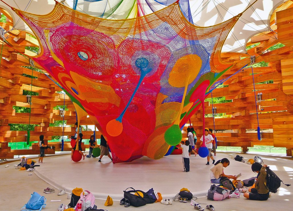 A colourful net stretched in a room