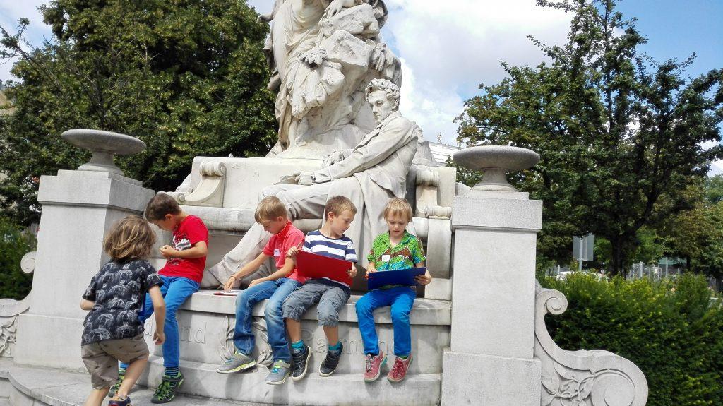 Children sitting on a monument
