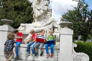 Children sitting on a monument