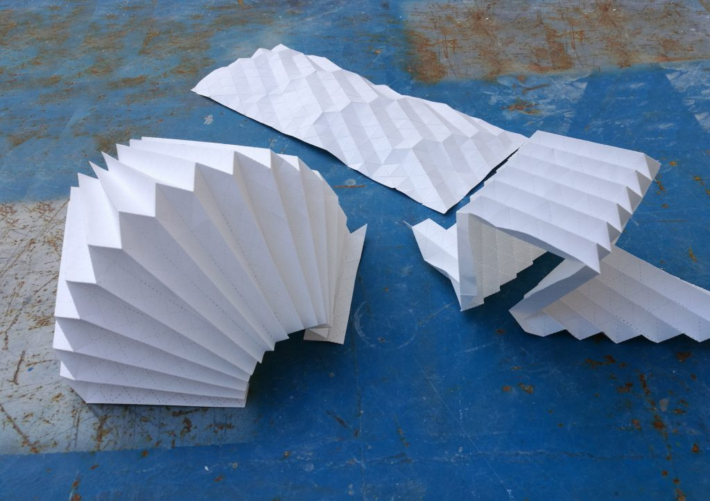 artfully folded white paper sheets