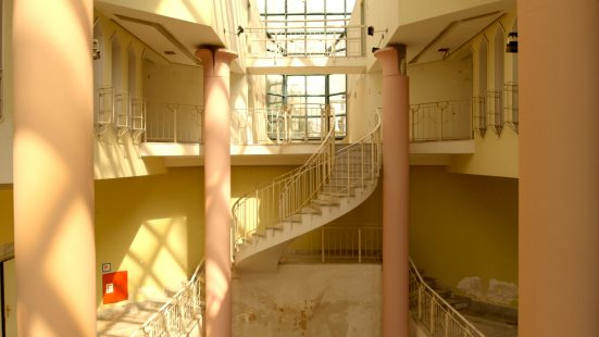 A curved staircase with two columns