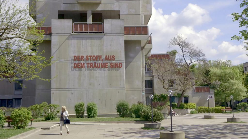 Multi-storey building with concrete facade and lettering