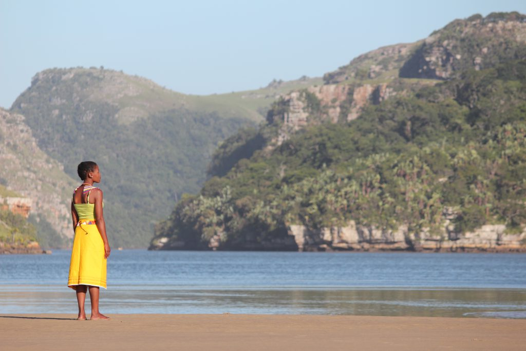 Woman with a yellow skirt on the beach