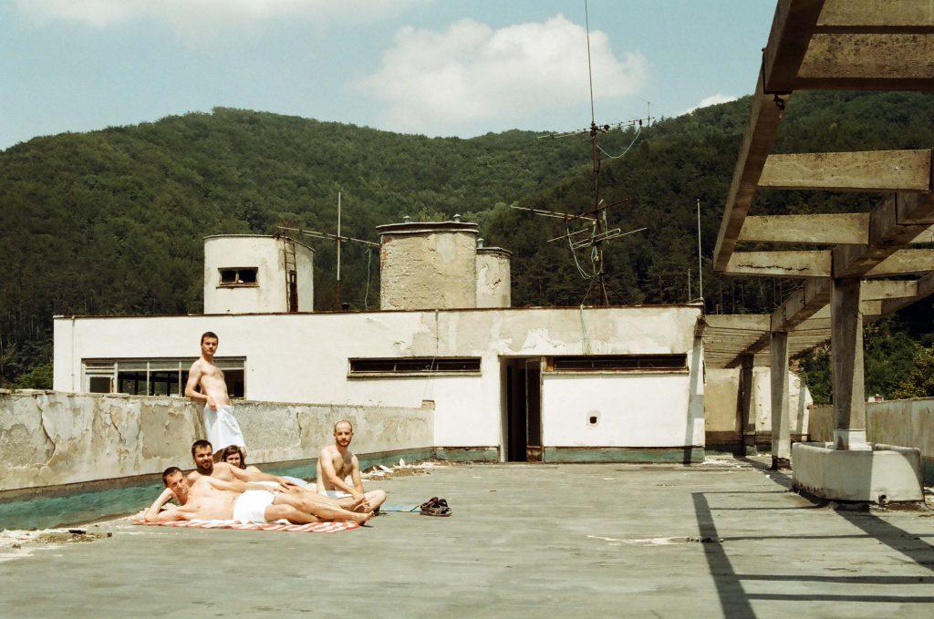 Five people on a terrace