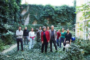 a group of people in an ivy-covered courtyard.