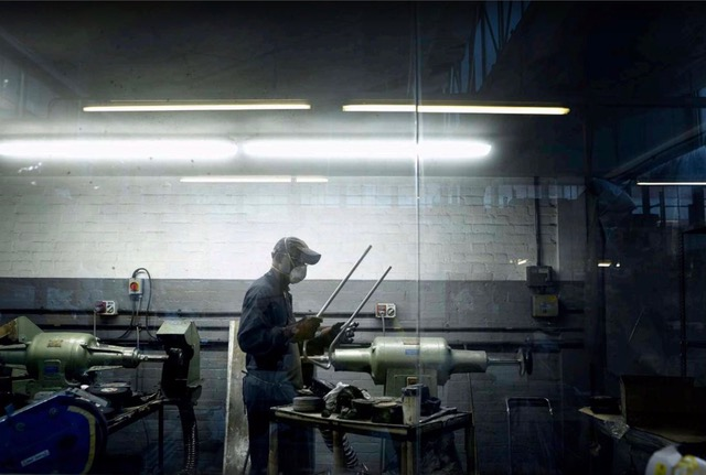man working in a factory with mask