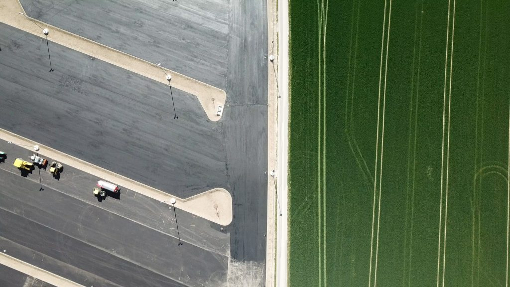 green fields and parking zone from bird's eye view