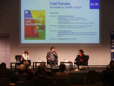 """3 persons in a dark room in front of a big screen with the title """"Cold War and Architecture"""