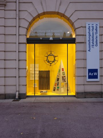 Shop window with yellow background and pyramid