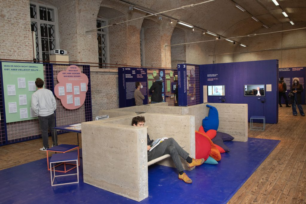 Concrete bunk in an exhibition with blue walls