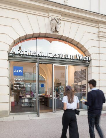 2 people going to an entrance with Architekturzentrum Wien