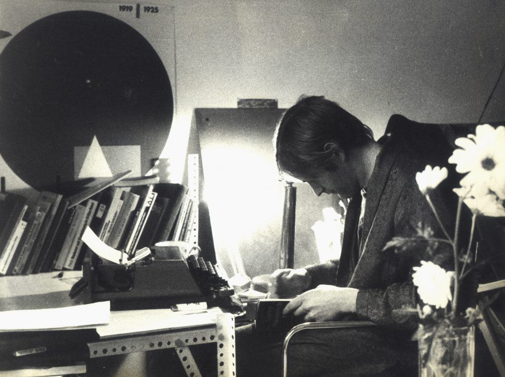 black and white photo with man reading bent forward