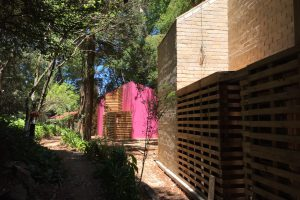 Brick and wood houses with pink coloured walls