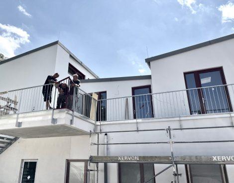 3 men working on a railing